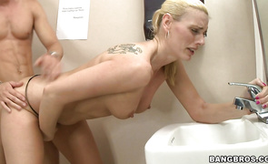 Divine blonde chick Darryl Hanah is sucking a large sausage and getting ready to ride it like crazy
