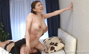 Pungent Kiriko Kasumi puts a knob in her face hole and sucks