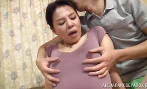 Classy mature beauty with large tits eagerly bends over for a brutal man