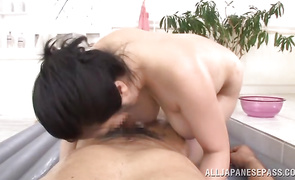 Nasty bosomed mature Minako Komukai with a tight body rides a stiff member