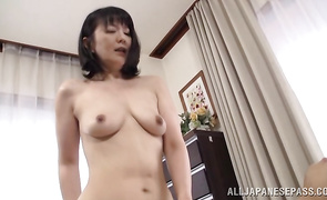Luxurious older Hitomi Enjou plays with a giant beef bayonet